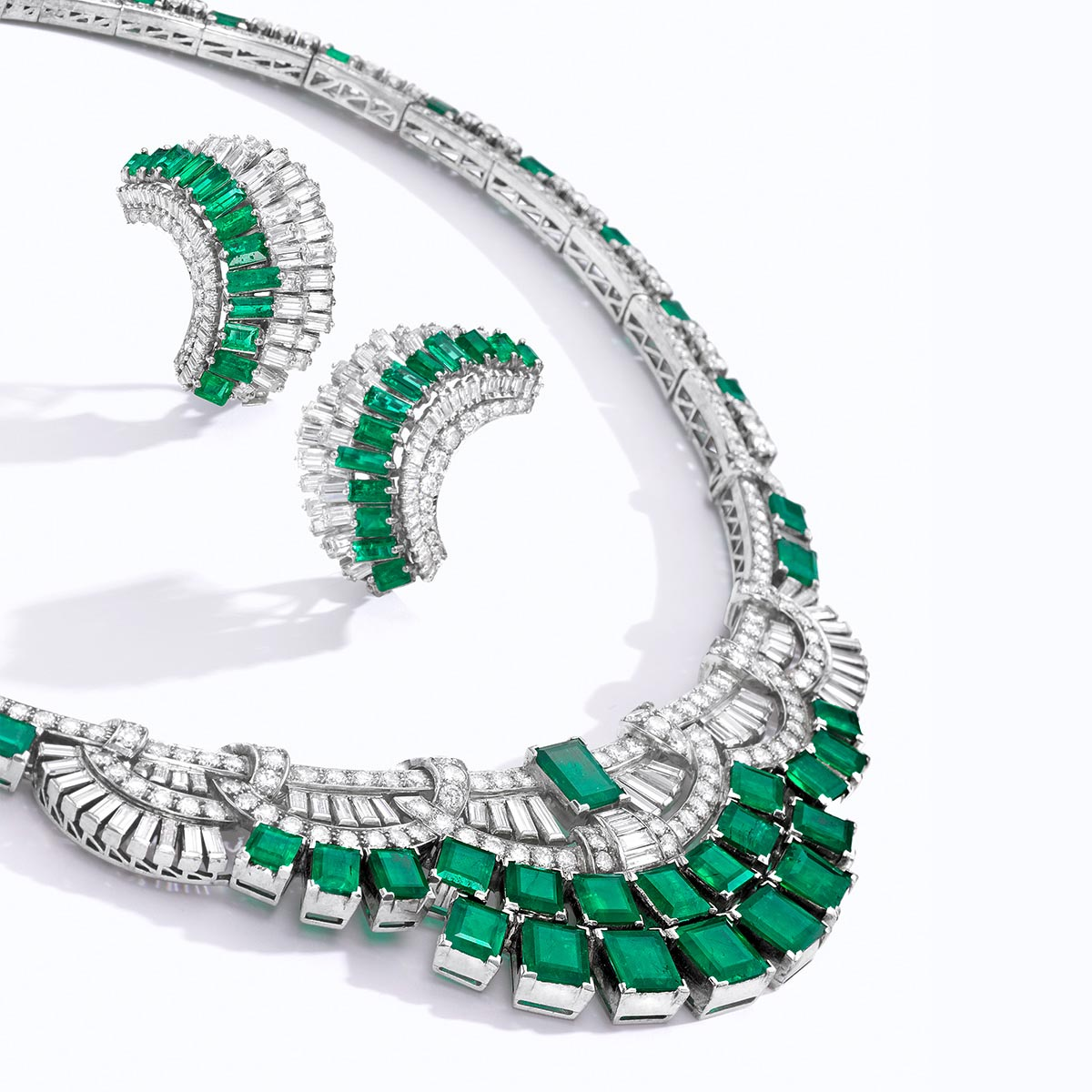 An emerald, diamond and platinum necklace and earrings