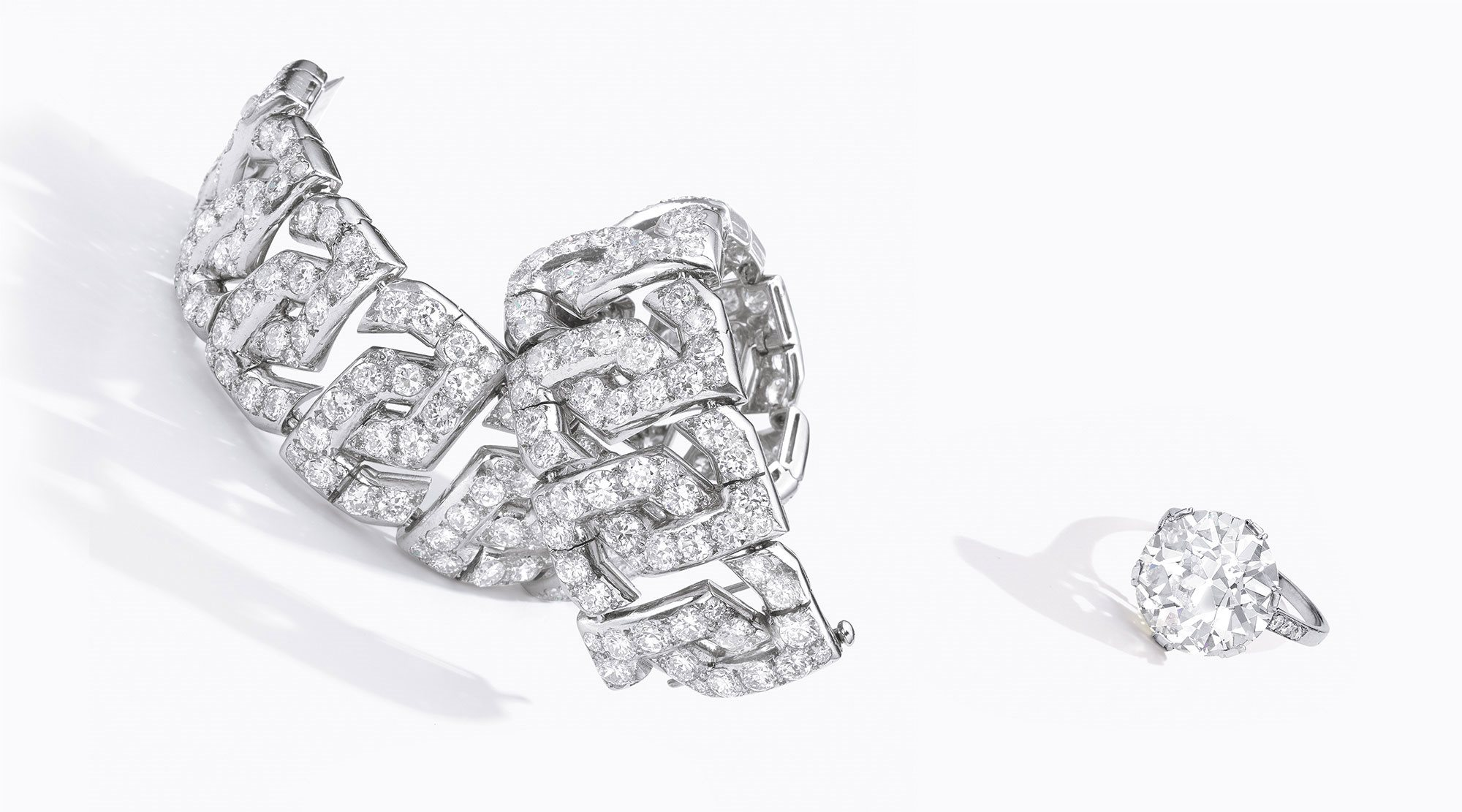 A diamond and platinum bracelet, Cartier, and an Art Deco diamond and platinum bracelet