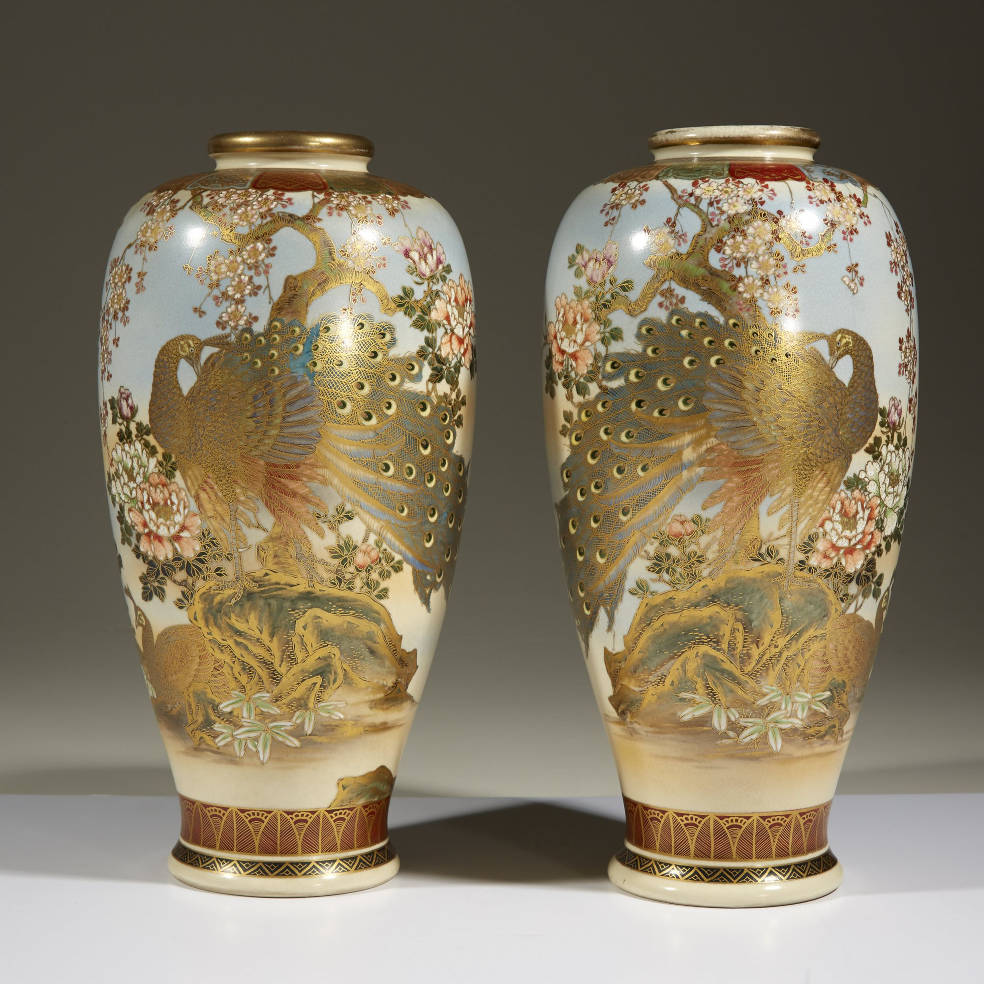 Lot 192 | A pair of Satsuma-type enameled pottery vases, signed Gyokuzan, late 19th/early 20th century, 12 ½ inches high