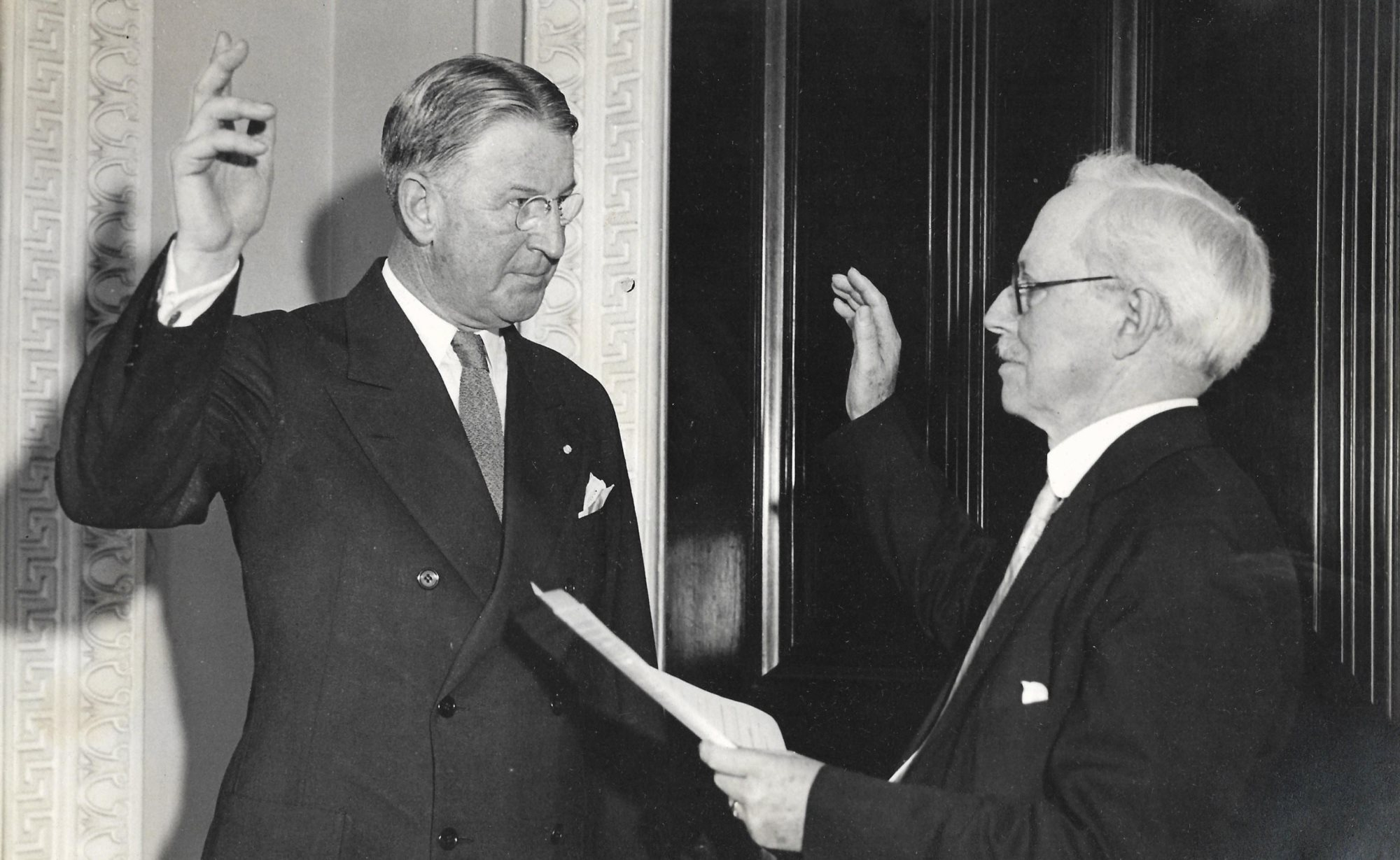 Alexander Weddell takes oath as official Ambassador to Argentina before Professor William H. McNeill, August 1, 1933