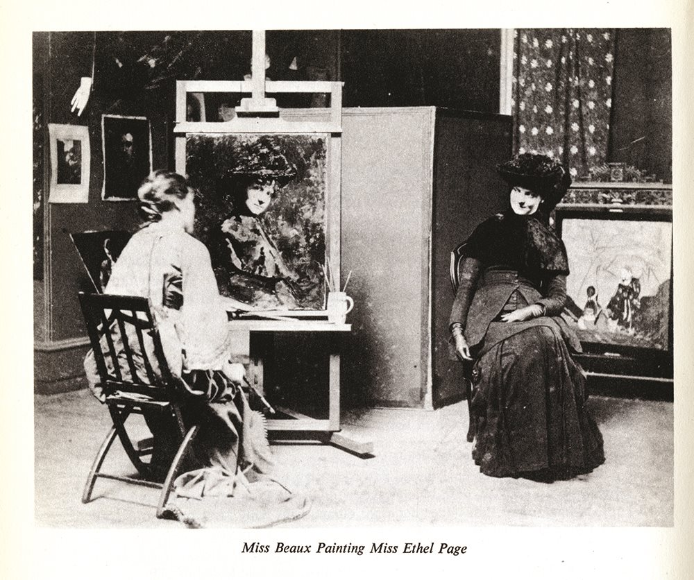 Seated in her studio in front of her painting, the smiling Ethel Page poses for Cecilia,