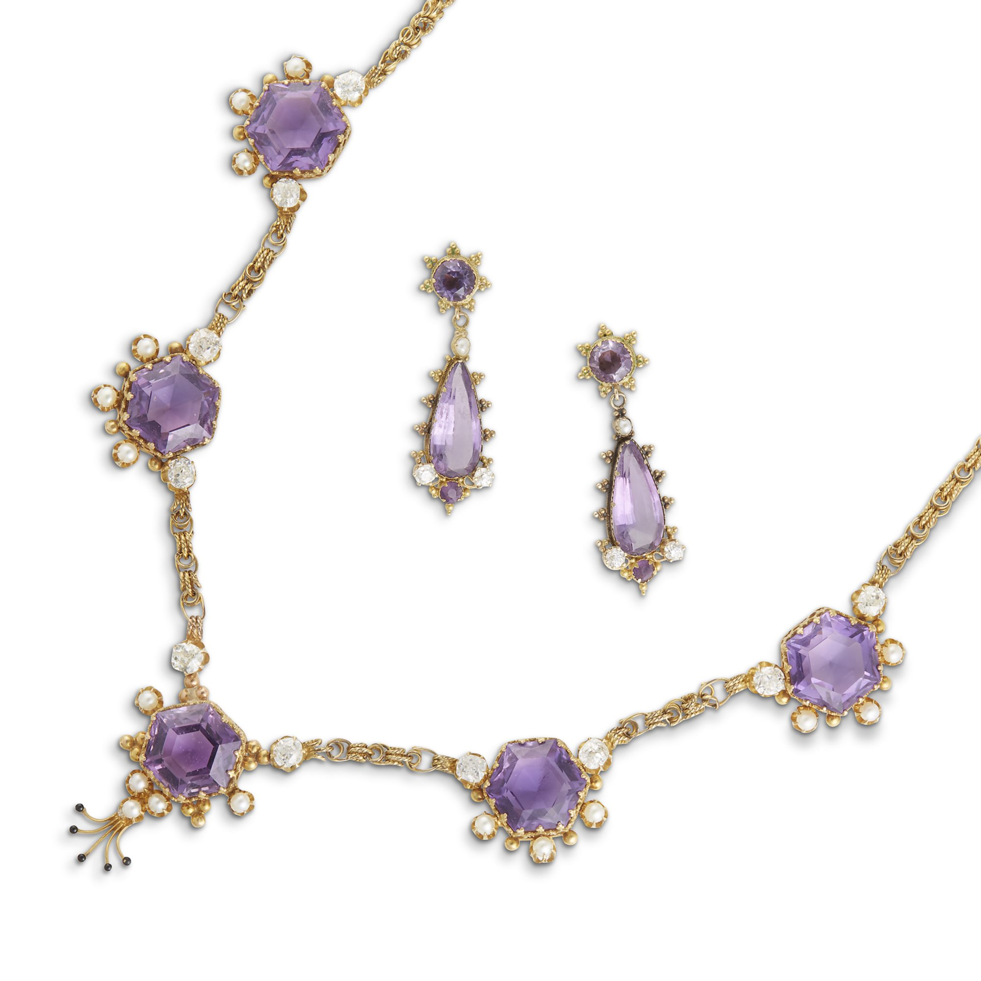An amethyst, diamond, cultured pearl and fourteen karat gold necklace, earrings and ring. Sold at Freeman's for $3,000