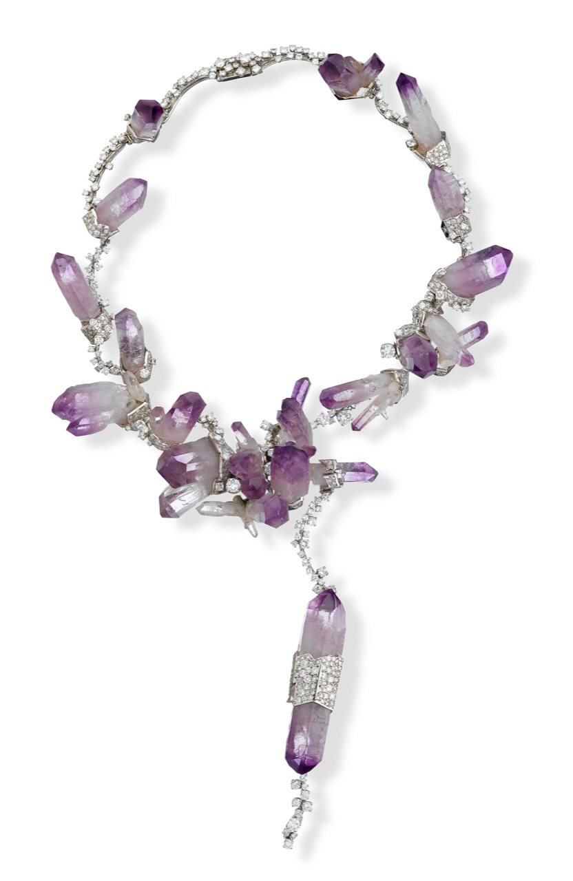 An amethyst, 15.00 carat diamond and platinum necklace, Jean Vendome abstract motif with rough amethyst crystals and set throughout with single and round brilliant-cut diamonds. Sold at Freeman's for $27,500