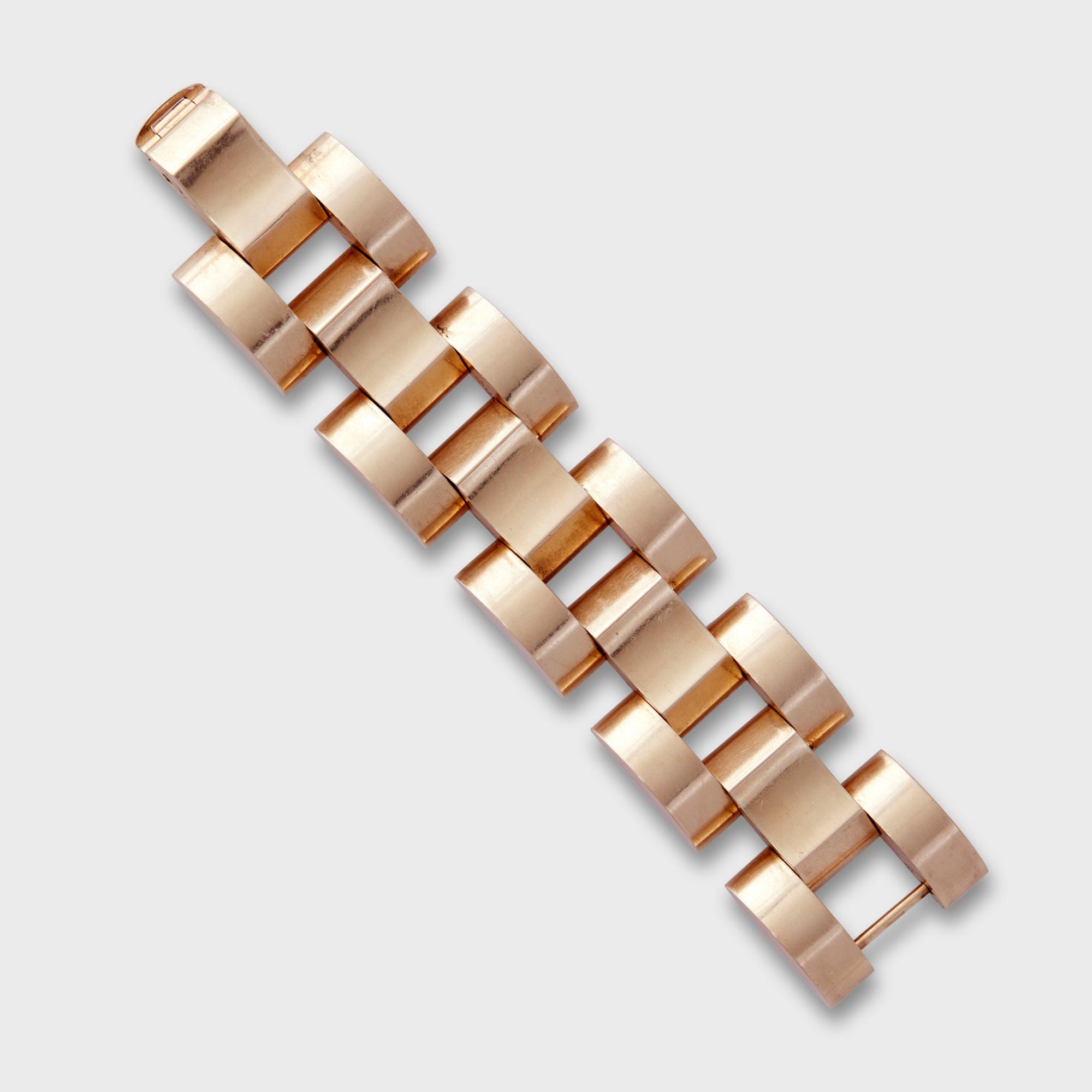 Lot 132   A fourteen karat gold 'Tank Track' strap bracelet, Ca. 1940