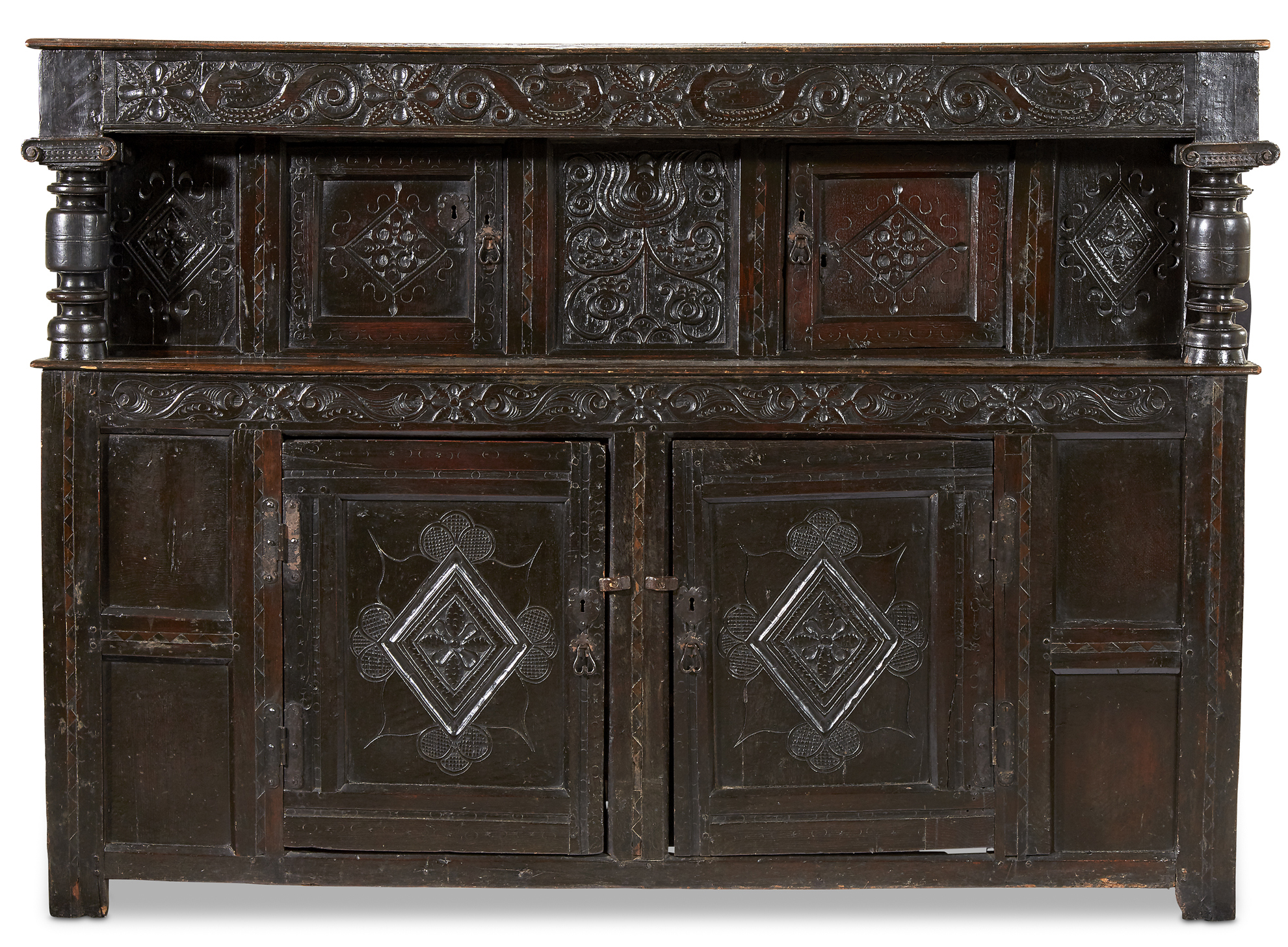 Lot 31: A Large and Fine Elizabethan/James I Carved Oak Court Cupboard, Early 17th Century, $6,000-8,000, to be offered at Freeman's on 10 April 2019