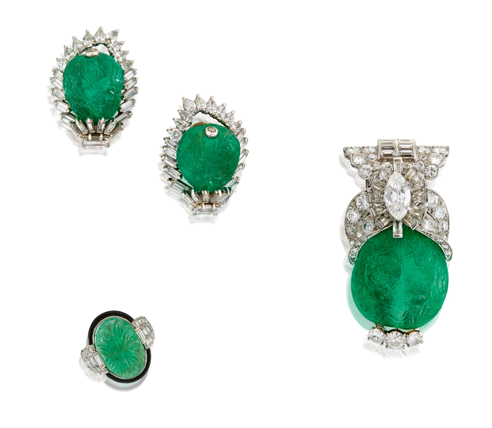 Clockwise: Lot 171: Carved emerald, diamond & platinum ear clips, Monture Cartier, $40,000-60,000; Lot 173: Carved emerald, diamond & platinum brooch, Cartier, $60,000-80,000; Lot 172: Art Deco platinum, emerald, diamond & enamel ring, $5,000-7,000