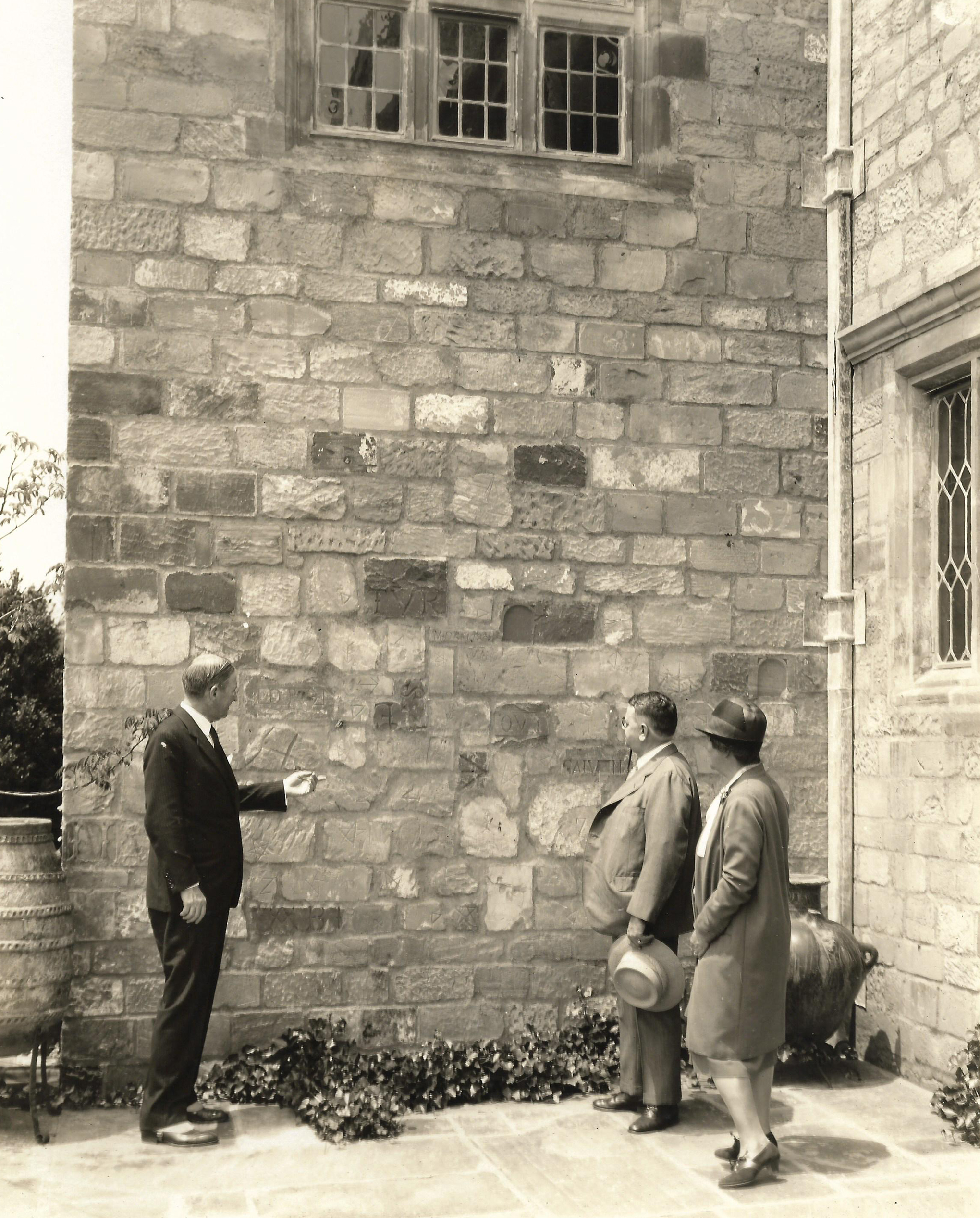 Alexander Weddell Showing Mason's Marks on the Outside Wall of Virginia House, East Facade, Archival Image Courtesy of the Virginia Museum of History and Culture