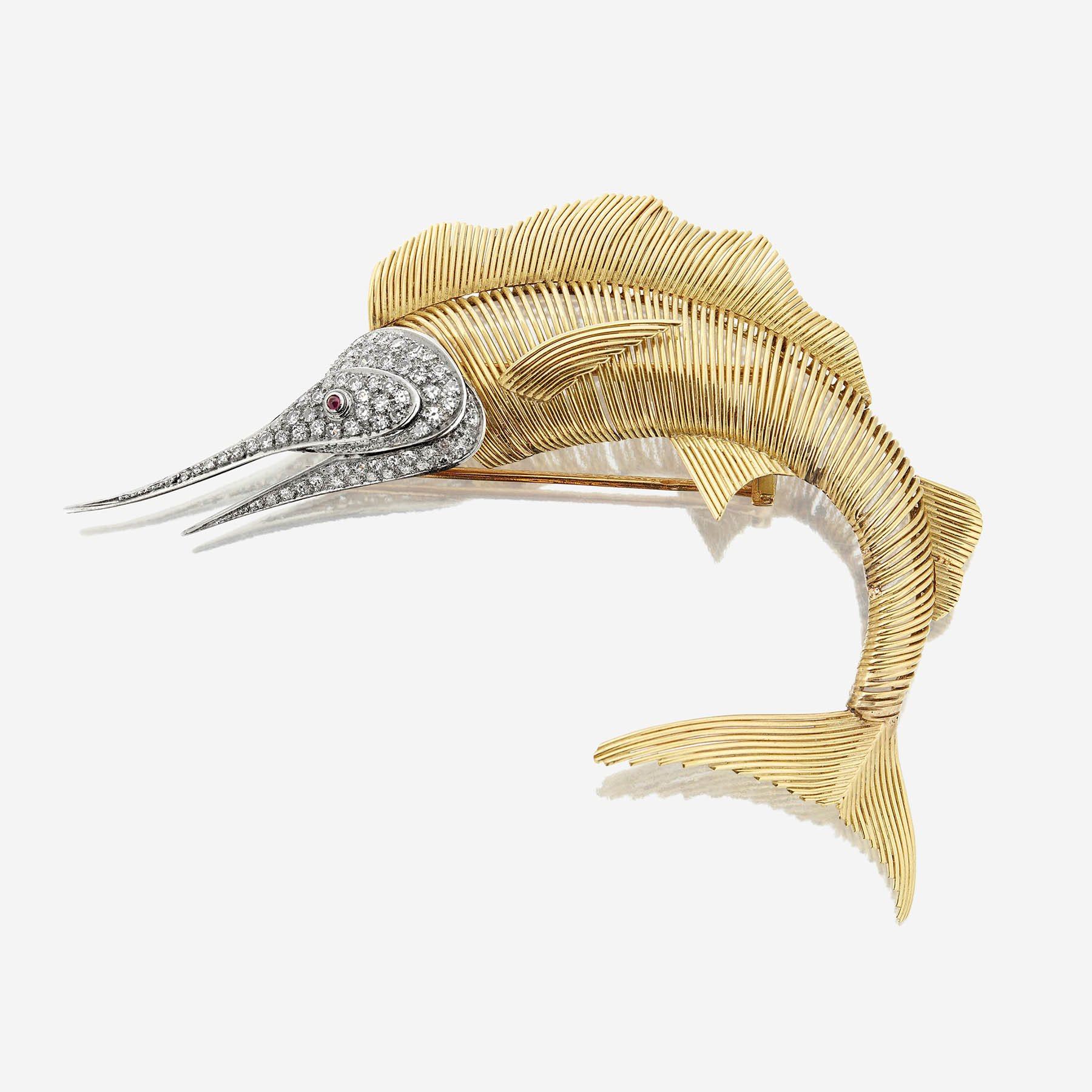 A diamond and eighteen karat bicolor gold clip brooch