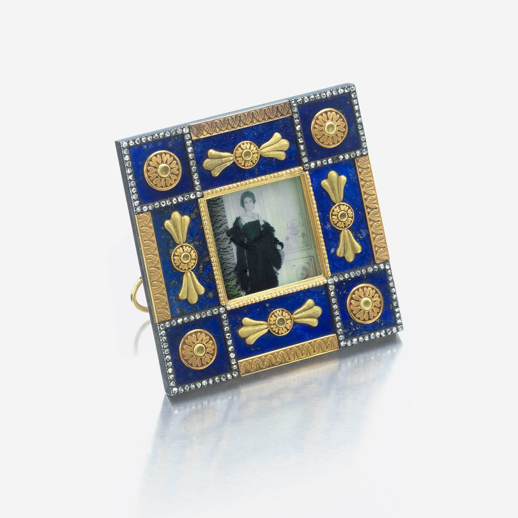 A bicolored gold-mounted lapis lazuli and diamond miniature picture frame, Fabergé