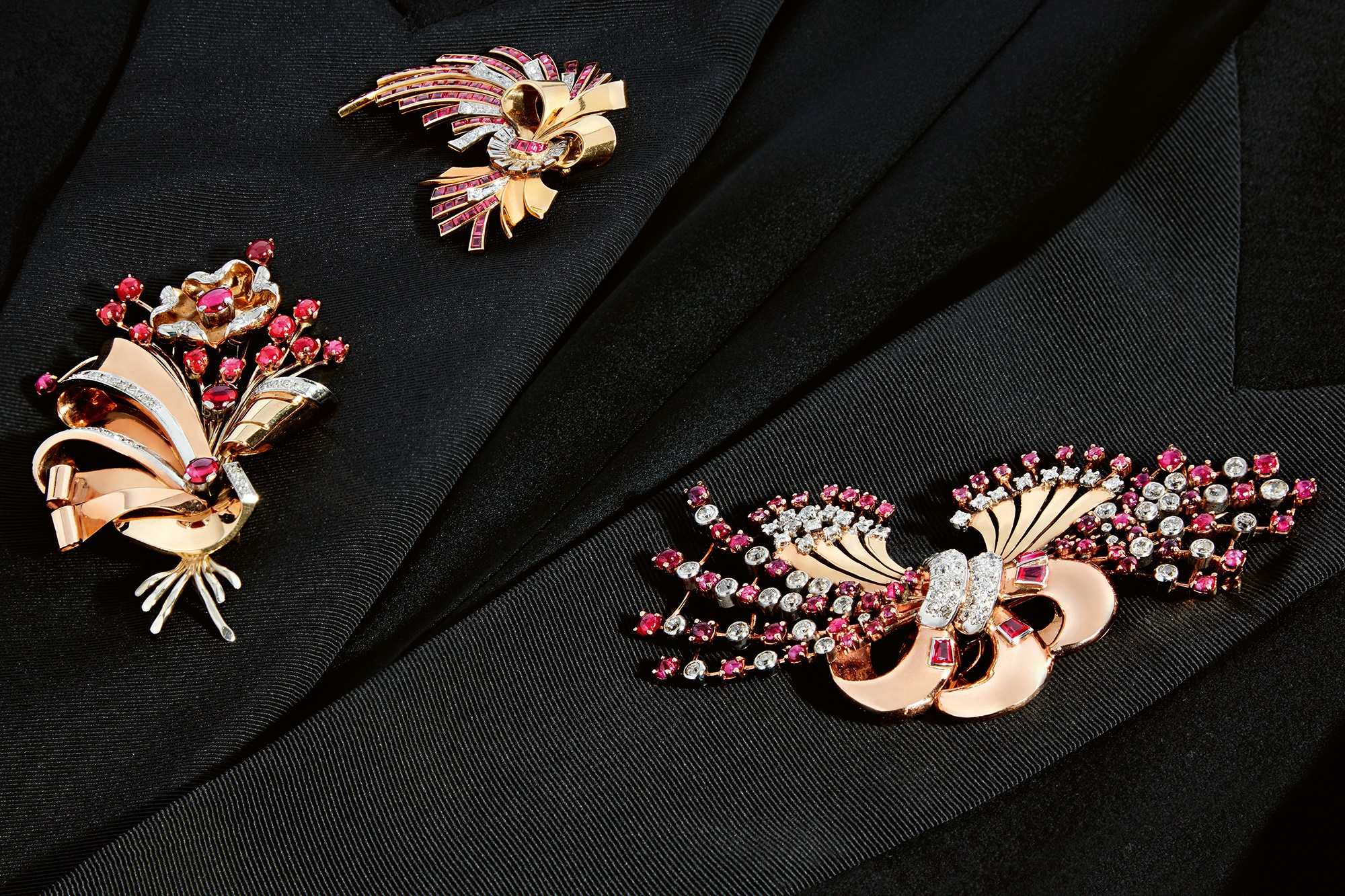 retro gold and gemset brooches on black fabric