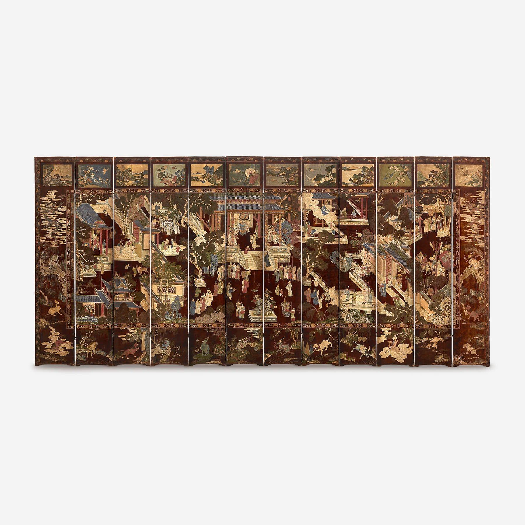 "Chinese carved twelve-panel ""Coromandel"" folding screen"