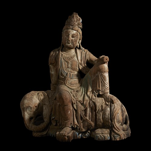 Lot 196 - A large Chinese carved wood figure of Samantabhadra, seated on an elephant
