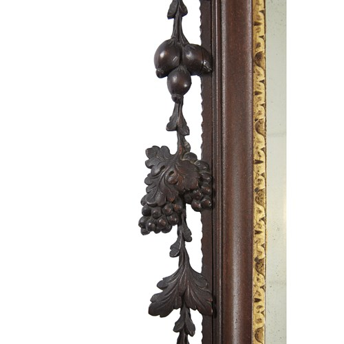 Lot 104 - Chippendale carved mahogany looking glass with phoenix cartouche