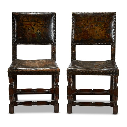 Lot 36 - A RARE PAIR OF CHARLES II OAK AND POLYCHROME PAINTED CORDOVAN LEATHER CHAIRS