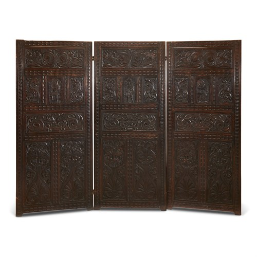 Lot 28 - A JACOBEAN STYLE CARVED OAK THREE-PANEL FLOOR SCREEN
