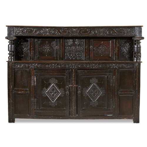 Lot 31 - A LARGE AND FINE ELIZABETHAN/JAMES I CARVED OAK COURT CUPBOARD