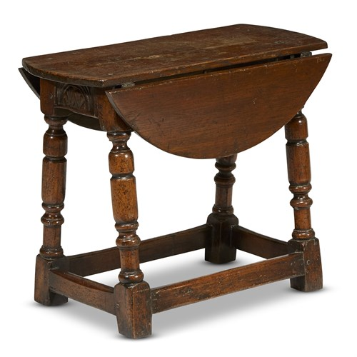 Lot 13 - A MODIFIED JACOBEAN CARVED OAK JOINED STOOL