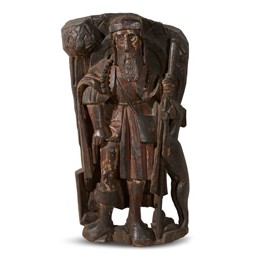 Lot 90 - A FRENCH LATE GOTHIC CARVED WALNUT FIGURE OF SAINT ROCH WITH TRACES OF ORIGINAL PIGMENT