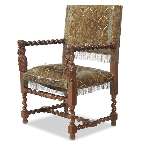 Lot 49 - A JACOBEAN STYLE CARVED WALNUT ARMCHAIR WITH FIGURAL ARM RESTS
