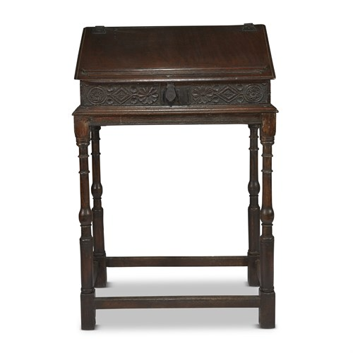 Lot 27 - A CHARLES II CARVED OAK SLANT-FRONT TRAVELING DESK ON STAND
