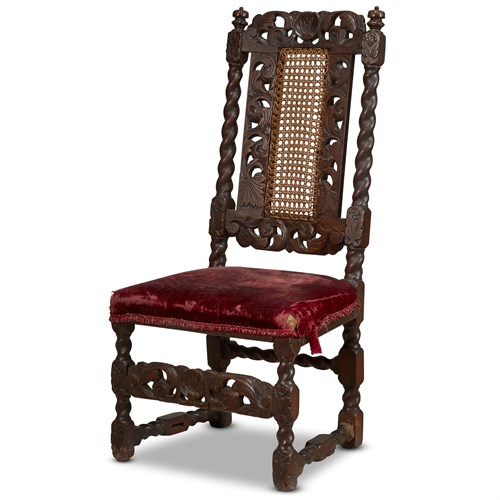 Lot 23 - A JAMES II/WILLIAM & MARY CARVED WALNUT AND CANED SIDE CHAIR