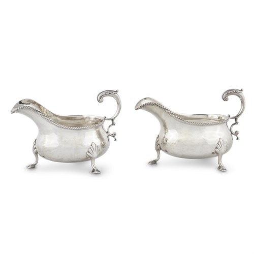 Lot 62 - A PAIR OF GEORGE III STERLING SILVER SAUCEBOATS