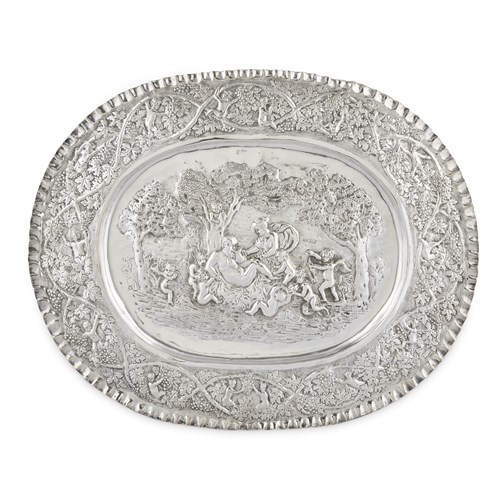 Lot 68 - A GERMAN SILVERED METAL RENAISSANCE REVIVAL REPOUSSÉ CHARGER