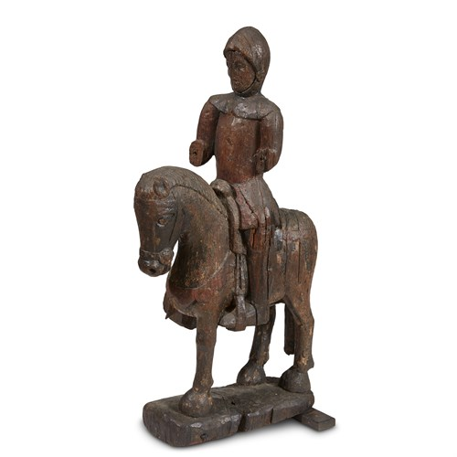 Lot 91 - A FRENCH GOTHIC OAK EQUESTRIAN STATUE OF SAINT MARTIN DE TOURS WITH TRACES OF ORIGINAL PIGMENT