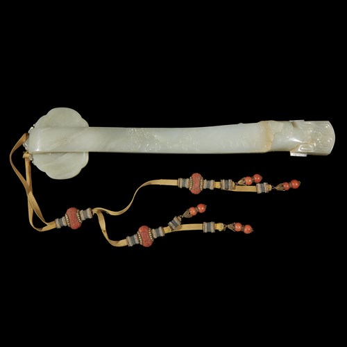 Lot 255 - A Chinese carved pale celadon jade ruyi scepter