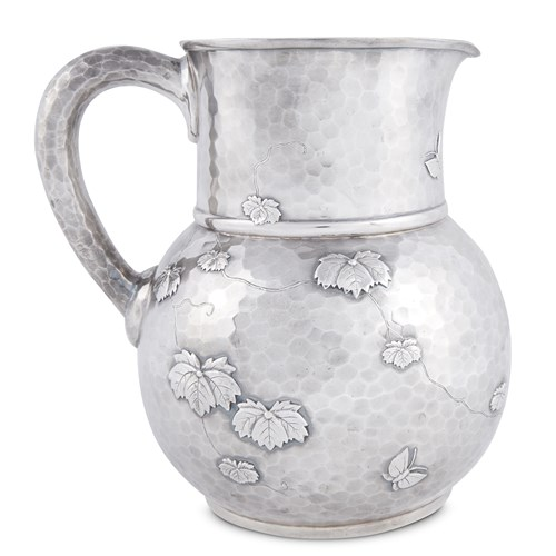 Lot 21 - Hammered sterling silver Japanese-style pitcher