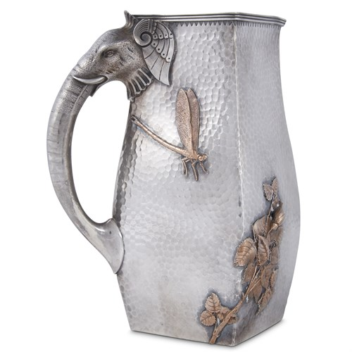 Lot 18 - Hammered sterling silver and mixed metal Japanese/Indian-style pitcher