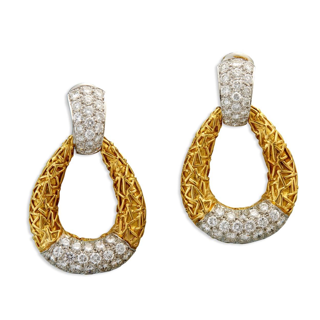 Lot 152 - A pair of diamond and two-tone eighteen karat gold earrings, Van Cleef & Arpels