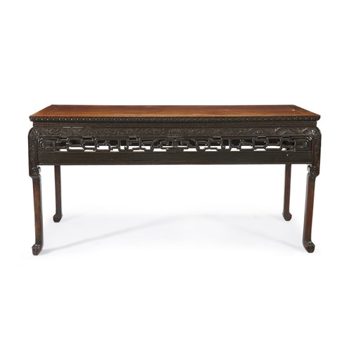 Lot 49 - A Chinese carved hardwood recessed-waist painting table