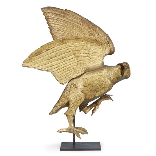Lot 91 - Carved and gilded figure of an eagle in flight