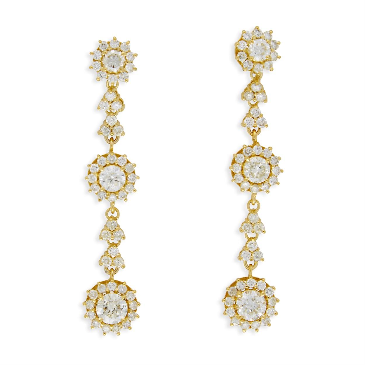 Lot 60 - A pair of diamond and eighteen karat gold pendant earrings