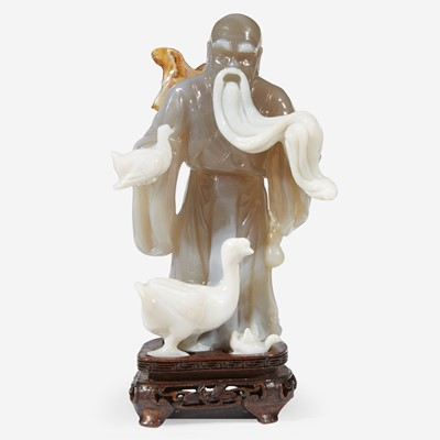 Lot 143 - A Chinese carved agate figure of Wang Xizhi 玛瑙俏雕王羲之