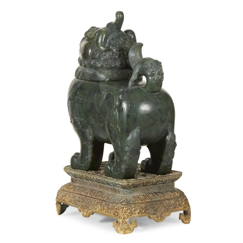 Lot 163 - A Chinese carved spinach green jade Luduan censer, gilt metal base