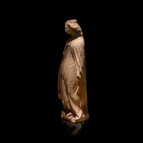 Lot 4 - A Burgundian carved limestone portal or funerary figure, likely Catherine of Alexandria