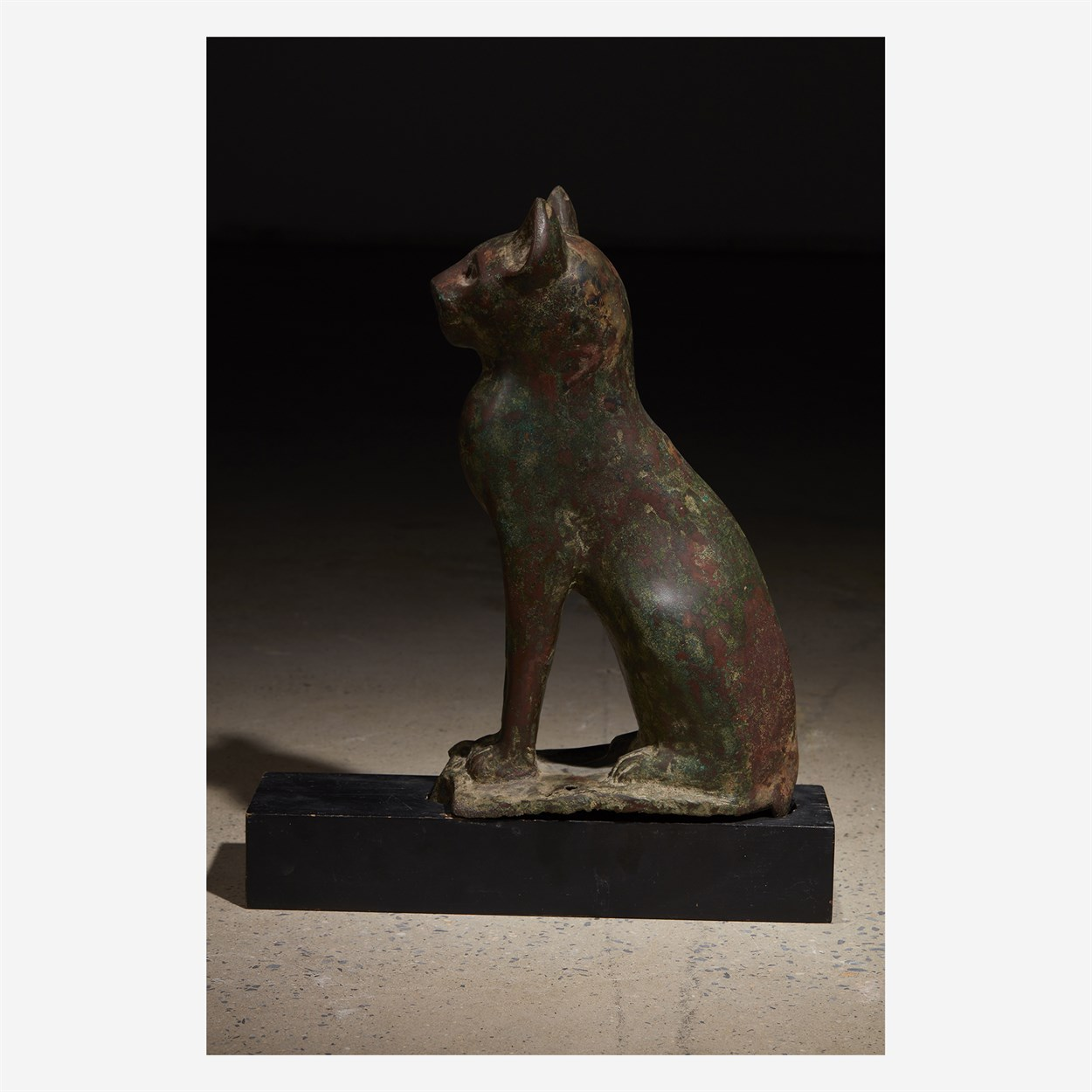 Lot 3 - An Egyptian bronze figure of a seated cat