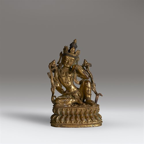 Lot 31 - A Nepalese or Tibetan gilt copper alloy figure of a bodhisattva