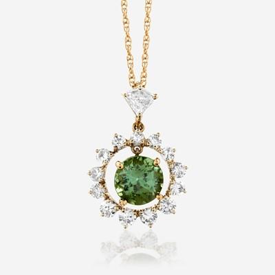 Lot 179 - A green tourmaline and diamond pendant