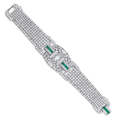 Lot 114 - An Art Deco diamond, emerald, and platinum bracelet