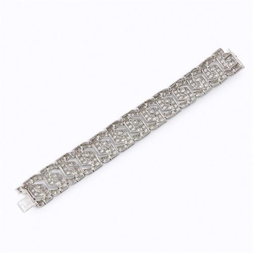Lot 124 - A diamond and platinum bracelet, Cartier