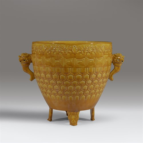 Lot 19 - A Chinese yellow-glazed archaistic vessel, Xing