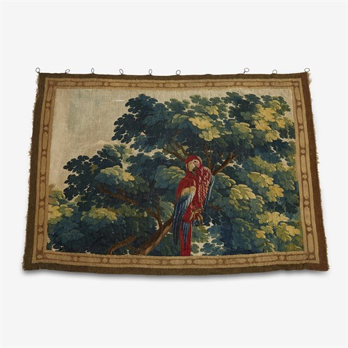Lot 1 - An Aubusson style verdure tapestry fragment