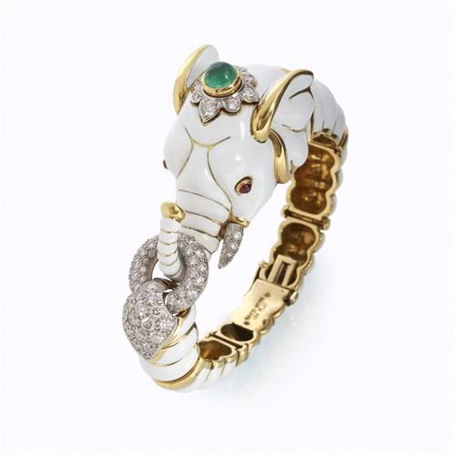Lot 110 - A white enamel, eighteen karat gold, diamond, and colored gemstone bracelet, David Webb