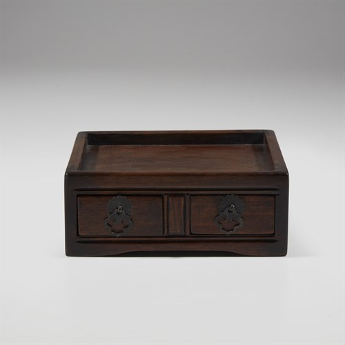 Lot 58 - A small Chinese hardwood stand with two drawers