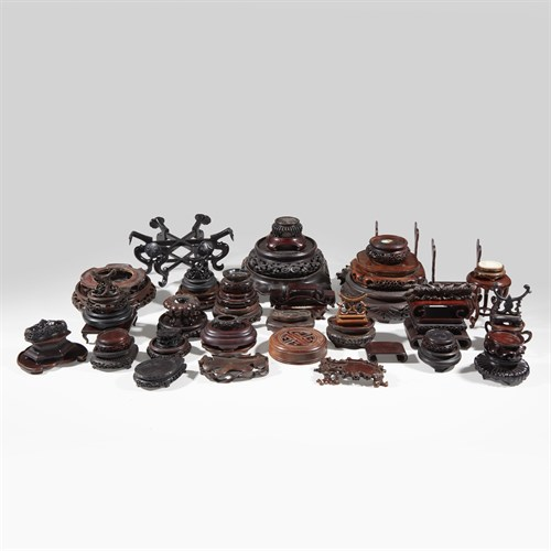 Lot 56 - A group of assorted Chinese wood stands and covers