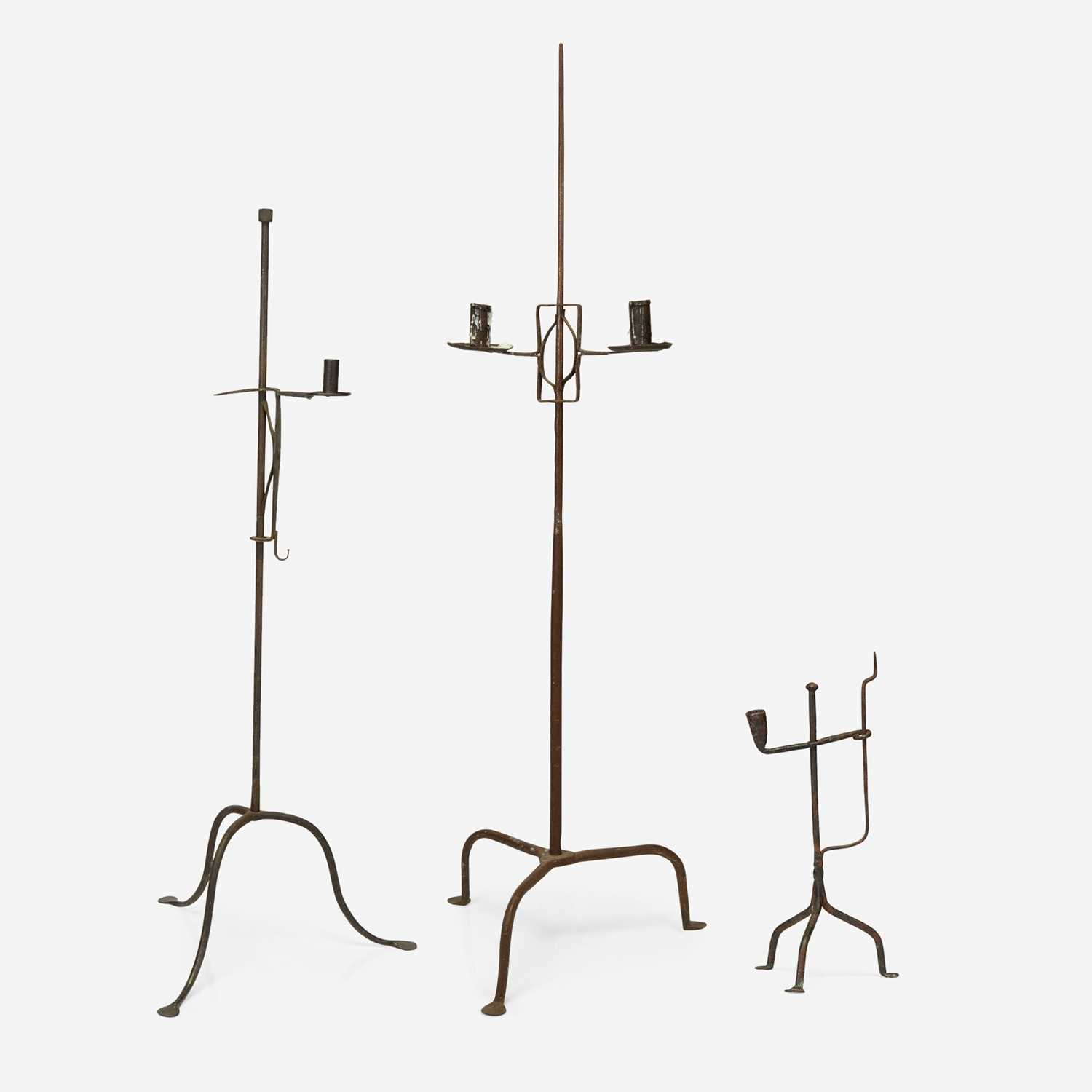 Lot 46 - A group of three wrought iron candle stands