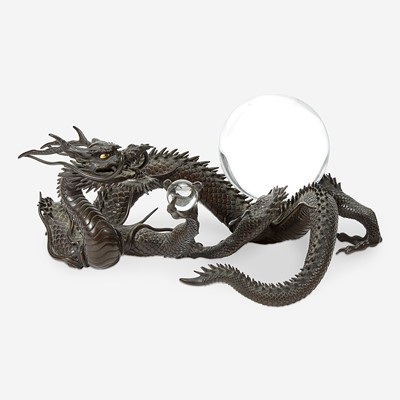 Lot 127 - A Japanese patinated bronze dragon and rock crystal sphere
